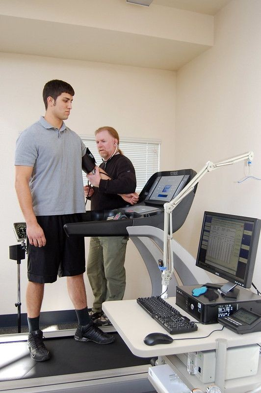 A student has his vitals checked by a professor in the Kinesiology lab