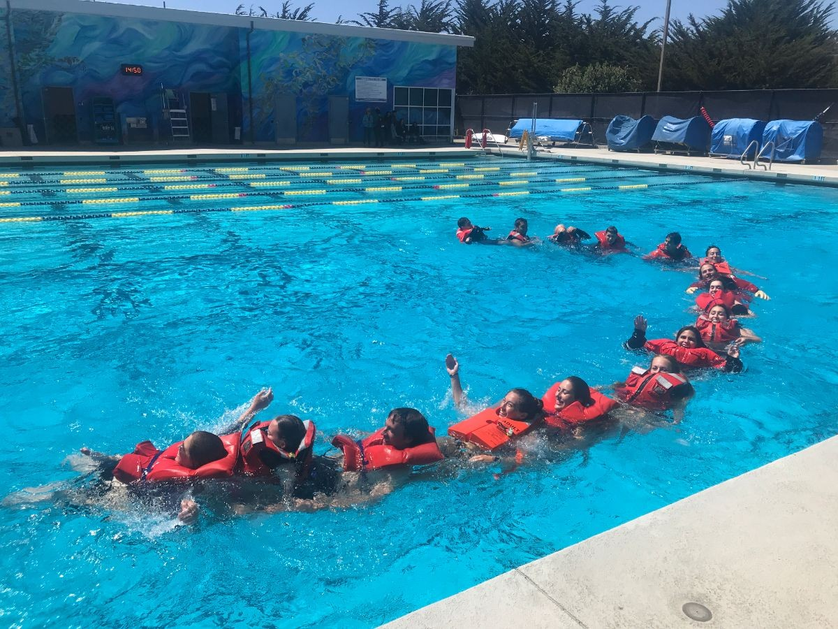 Students learning boating safety in the pool