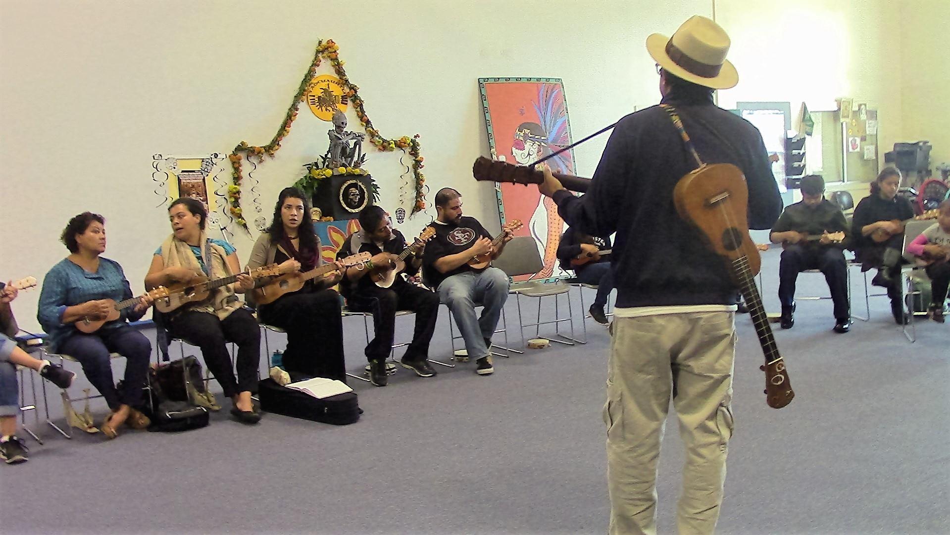 People playing on guitar/ukulele