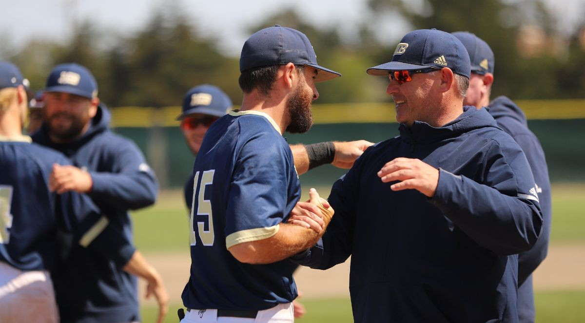 Coach Walt White greeting a player