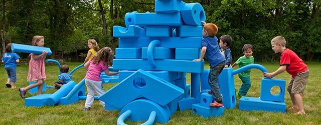 a group of kids playing on a Styrofoam structure