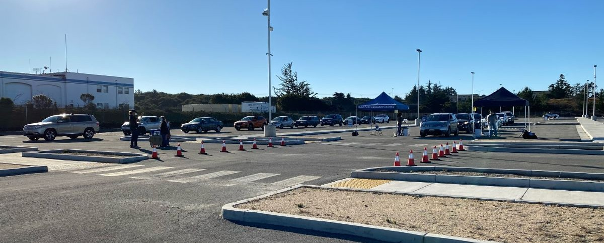 Vehicles lined up for drive-thru flu shots at Lot 59