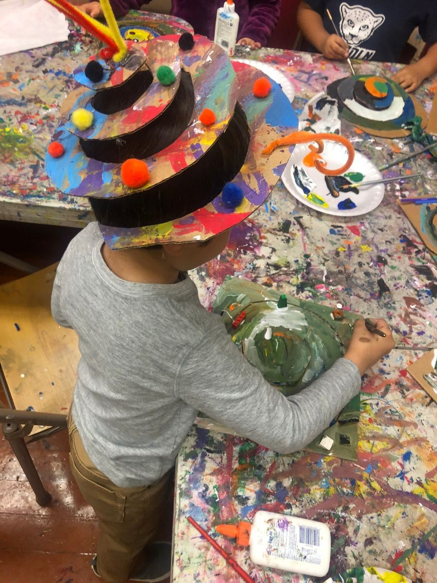 A child working with painting, and arts and crafts.