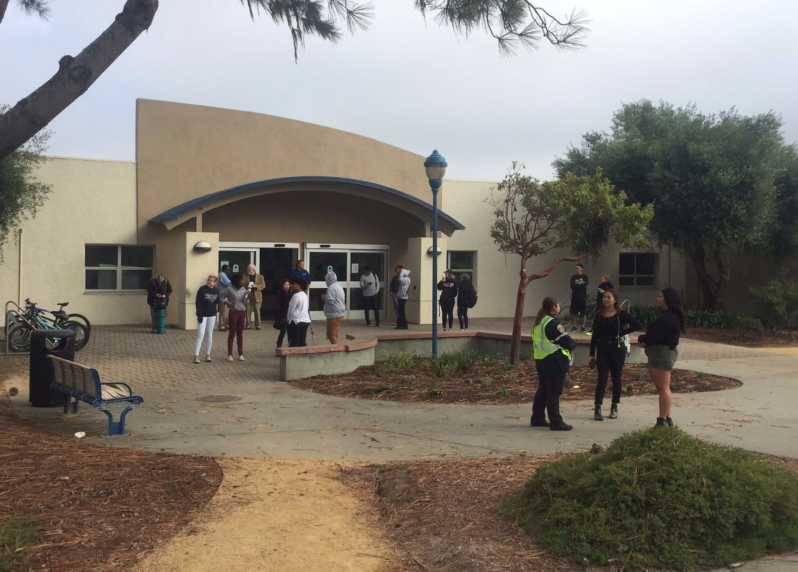 Students gather outside of the Otter Student Union during the Great Shakeout