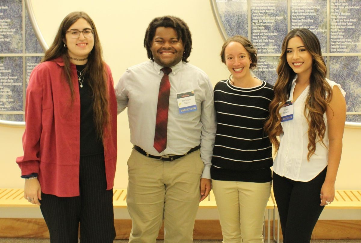 UROC Researchers stand with Dr. Jennifer Lovell at the 2019 Fall Showcase