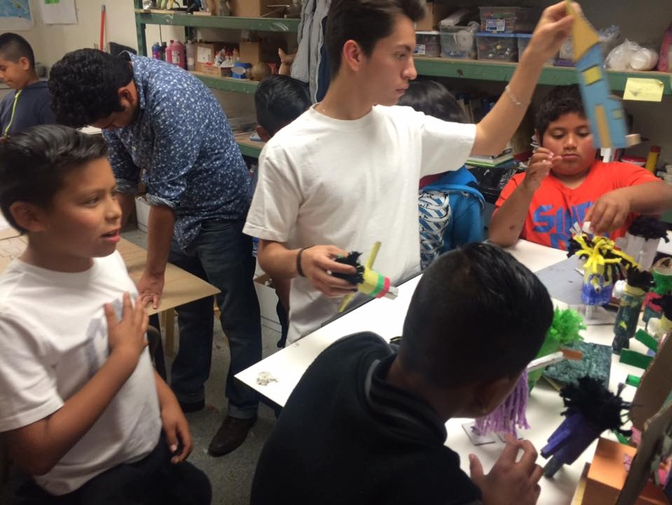 Hijos del Sol doing art workshops with students
