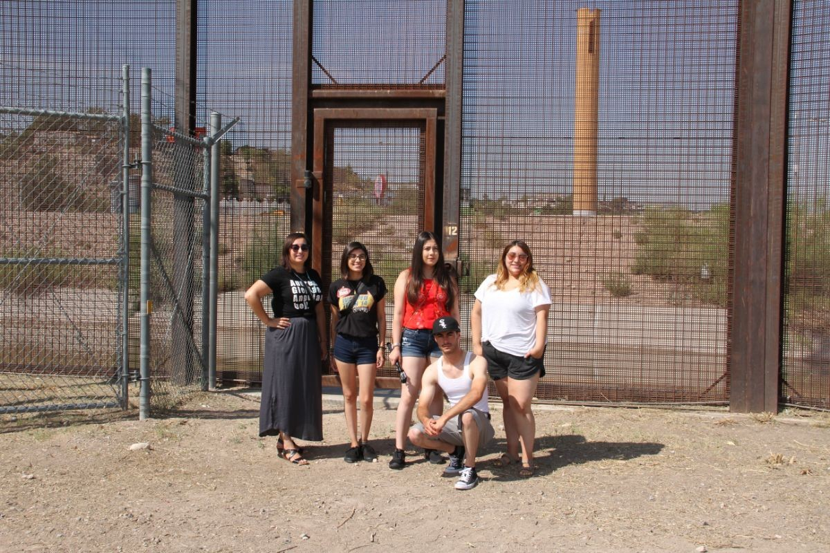 UROC Students standing in front of the Border Wall in El, Paso, TX