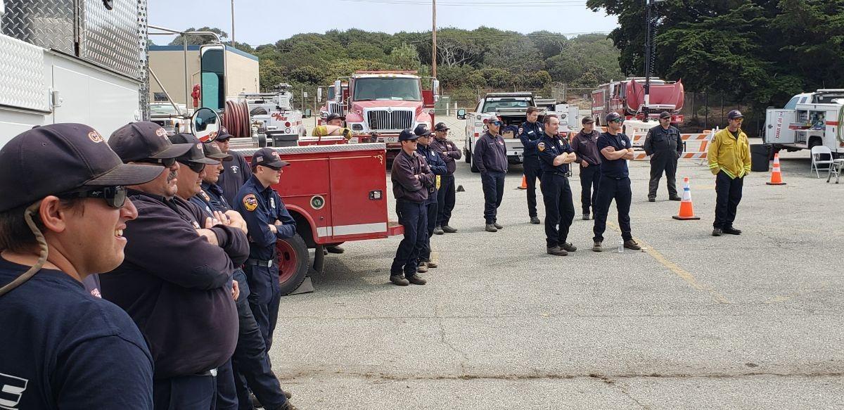 CAL-Fire firefighters assembled at a CSUMB parking lot.