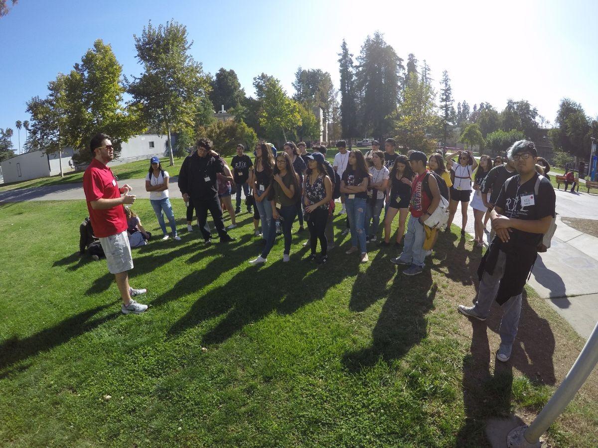 Students gather around a speaker from CSU Fresno.