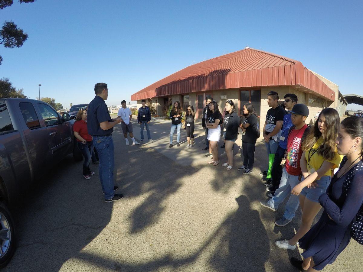 Students gather around speaker before touring around CSU Fresno.