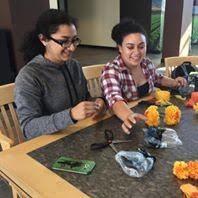 Girls working on making paper crafts
