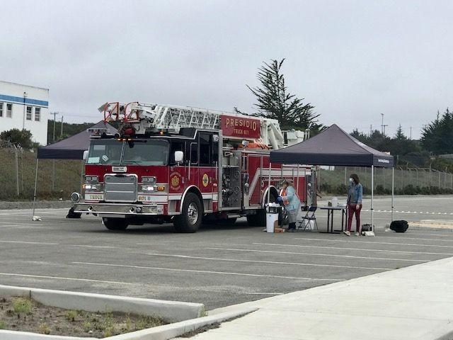 A fire engine pulls up to the drive-thru flu shot station