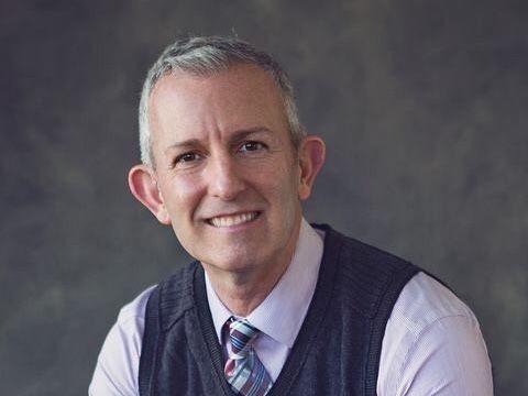 Dr. Scott D. Rhodes