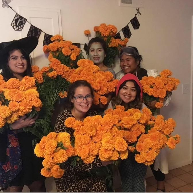 Group holding flowers for the altar