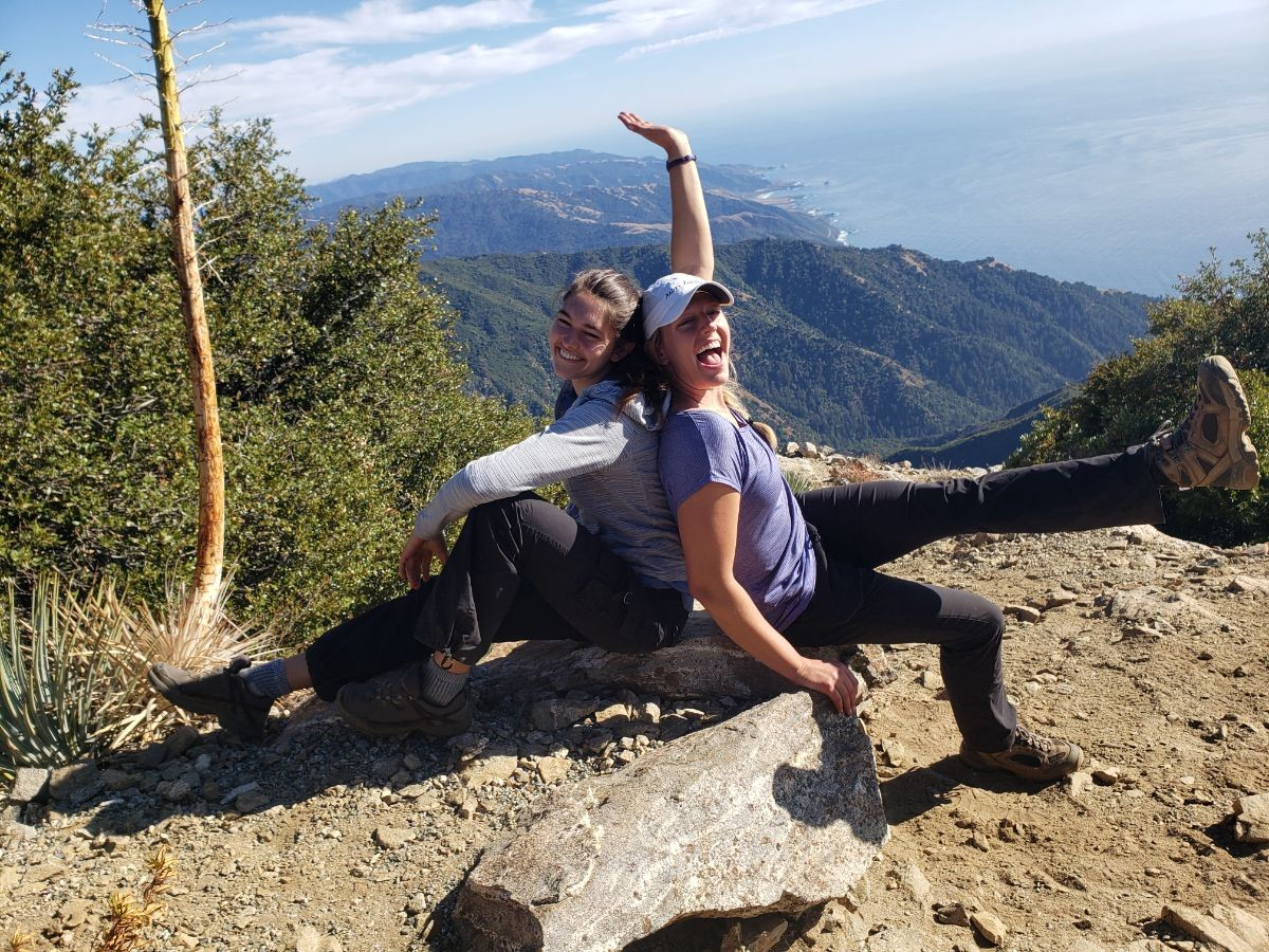Two hikers on a coastal mountain