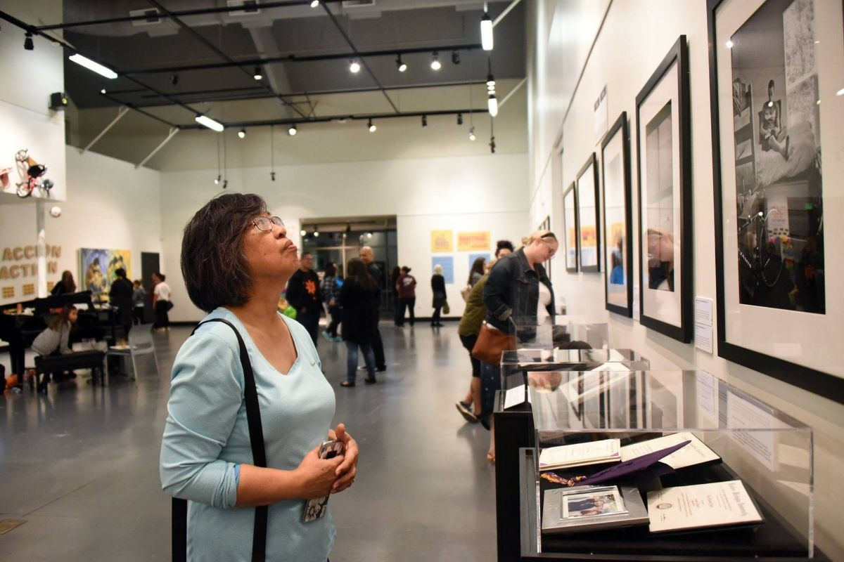 Woman viewing photographs in the art gallery