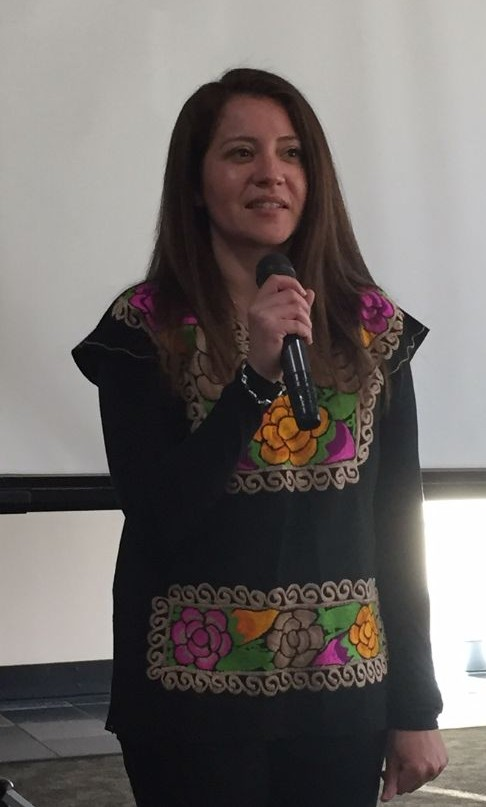 Dr. Christine Fernandez welcomes the Calaveras audience