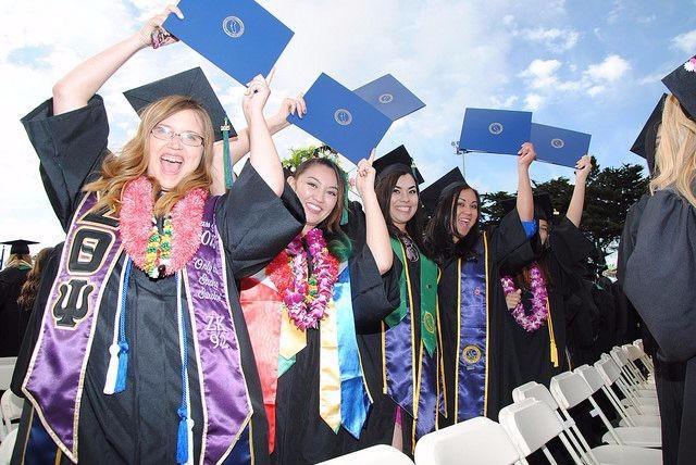 Graduation at CSUMB five girls holding up their diplomas