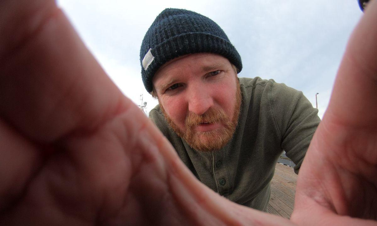 Image of Ryan Solymar holding camera