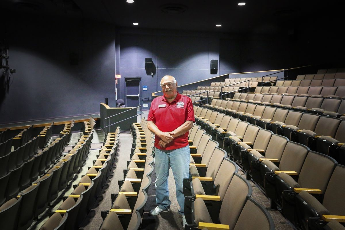 Phil Esparza standing in the World Theater