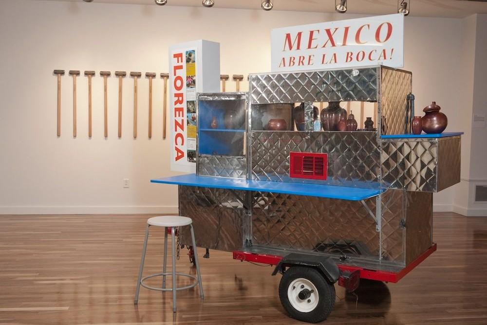 Cabrera artwork taco truck with pottery sign reads mexico abre la boca