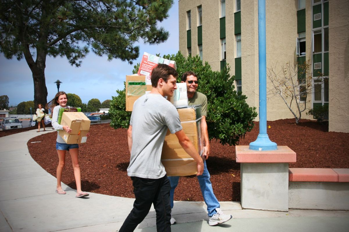 People moving into the campus residential halls