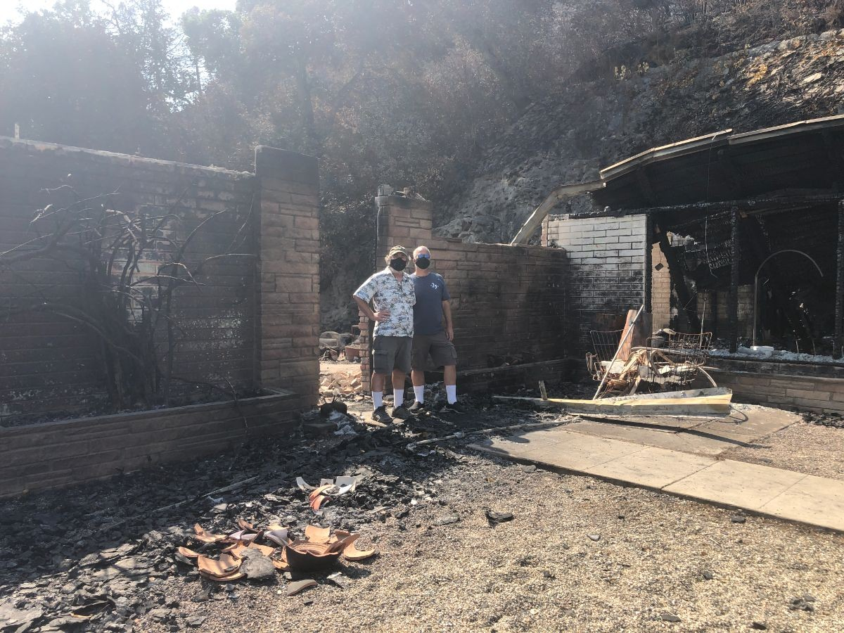 Kevin and Chip at the front of their house after the fire